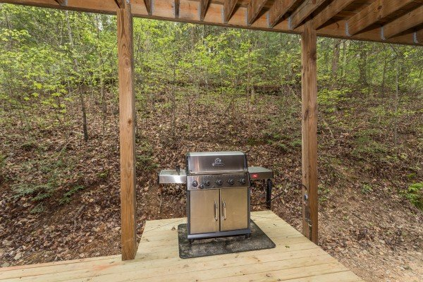 Grill on the lower deck at Timber Creek, a 4 bedroom cabin rental located in Pigeon Forge