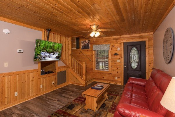 Living room with TV and sofa at Timber Creek, a 4 bedroom cabin rental located in Pigeon Forge