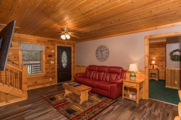 Living room with a TV and sofa at Timber Creek, a 4 bedroom cabin rental located in Pigeon Forge