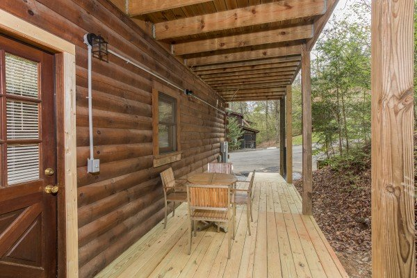 Deck with dining set at Timber Creek, a 4 bedroom cabin rental located in Pigeon Forge