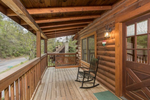 Porch swing and rocking chair at Timber Creek, a 4 bedroom cabin rental located in Pigeon Forge
