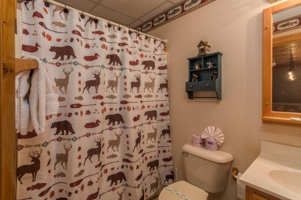 Bathroom with a tub and shower at Timber Creek, a 4 bedroom cabin rental located in Pigeon Forge