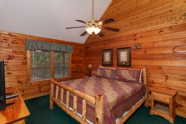 King log bed in a loft bedroom at Timber Creek, a 4 bedroom cabin rental located in Pigeon Forge