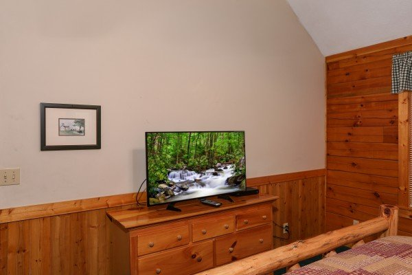 Dresser and TV in a loft bedroom at Timber Creek, a 4 bedroom cabin rental located in Pigeon Forge