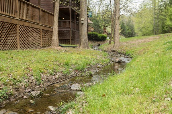 Small creek in the yard at Timber Creek, a 4 bedroom cabin rental located in Pigeon Forge