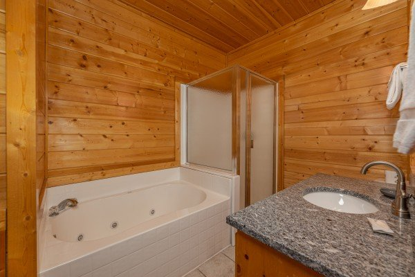 Jacuzzi in a bathroom at Grizzly's Den, a 5 bedroom cabin rental located in Gatlinburg