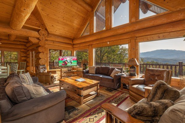 TV and mountain views in the living room at Grizzly's Den, a 5 bedroom cabin rental located in Gatlinburg