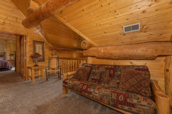 Futon in the loft at Grizzly's Den, a 5 bedroom cabin rental located in Gatlinburg