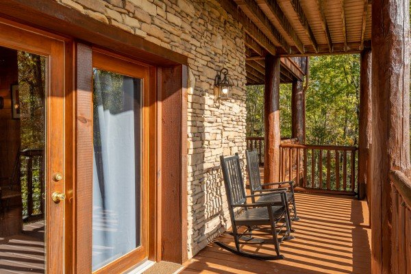 Deck with rocking chairs at Grizzly's Den, a 5 bedroom cabin rental located in Gatlinburg