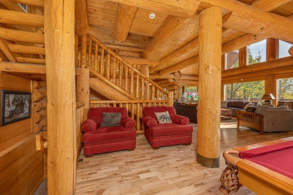Two large red chairs at Grizzly's Den, a 5 bedroom cabin rental located in Gatlinburg