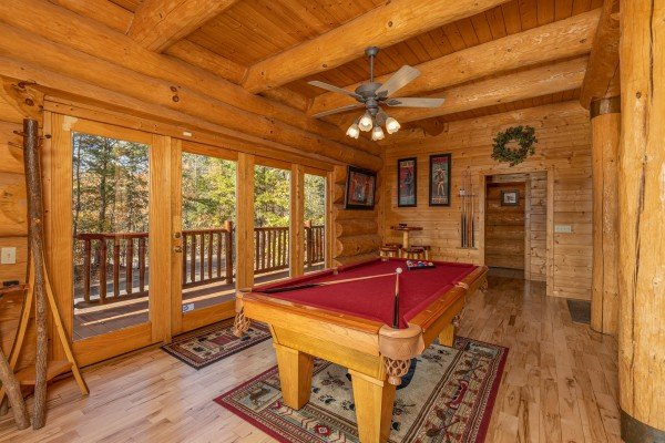Red felt pool table at Grizzly's Den, a 5 bedroom cabin rental located in Gatlinburg
