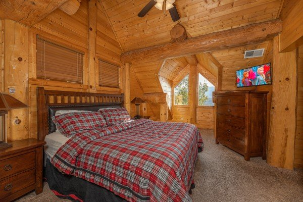 King bed, night stands, dresser, and TV in a bedroom at Grizzly's Den, a 5 bedroom cabin rental located in Gatlinburg