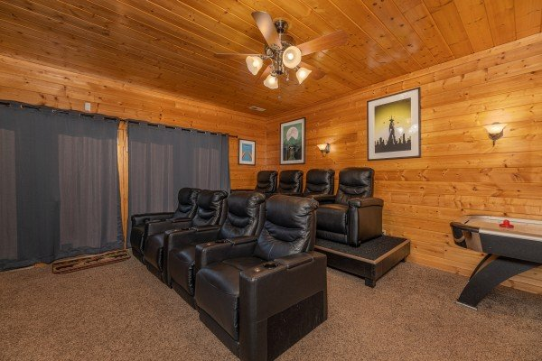 Seating in the theater room at Grizzly's Den, a 5 bedroom cabin rental located in Gatlinburg