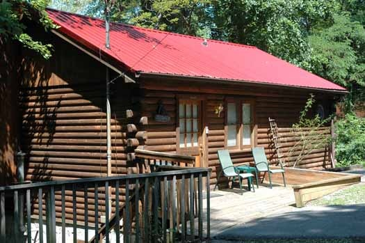 front porch of log cabin named bear kisses & hugs a 1 bedroom cabin rental located in pigeon forge