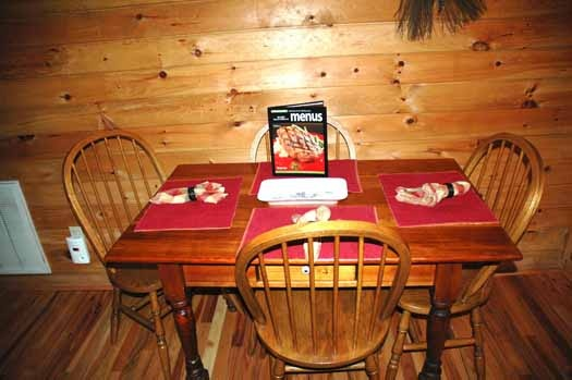 dining table for four people at bear kisses & hugs a 1 bedroom cabin rental located in pigeon forge