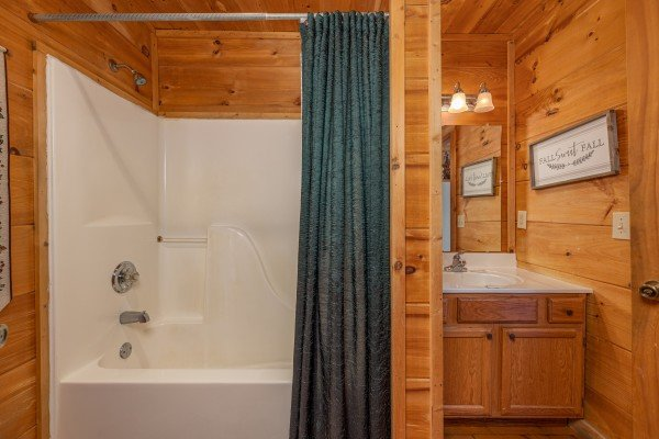 Bathroom with a tub and shower at Fallin' in Love, a 1 bedroom cabin rental located in Gatlinburg