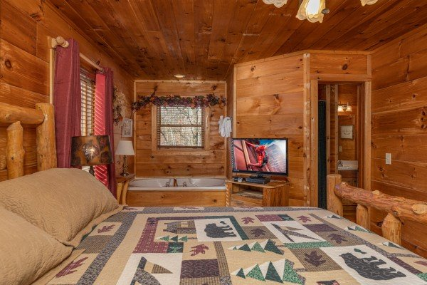 Bedroom with a TV and jacuzzi at Fallin' in Love, a 1 bedroom cabin rental located in Gatlinburg