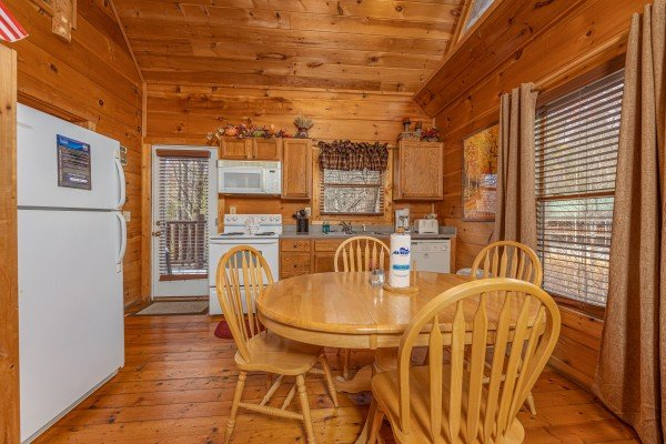 Dining table for 4 at Fallin' in Love, a 1 bedroom cabin rental located in Gatlinburg