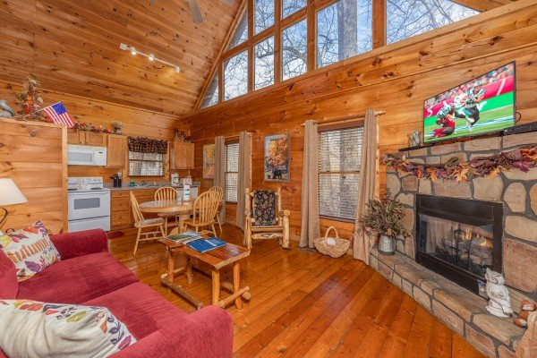 Living room with fireplace & TV at Fallin' in Love, a 1 bedroom cabin rental located in Gatlinburg