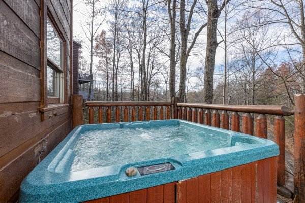 Hot tub on a deck at Fallin' in Love, a 1 bedroom cabin rental located in Gatlinburg