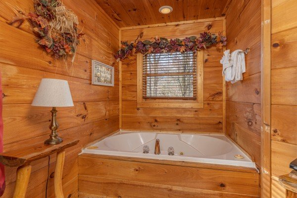 Jacuzzi in a bedroom at Fallin' in Love, a 1 bedroom cabin rental located in Gatlinburg