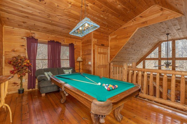Pool table in the loft at Fallin' in Love, a 1 bedroom cabin rental located in Gatlinburg