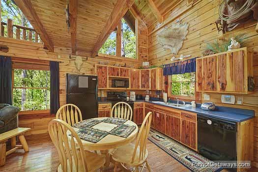 Kitchen and dining room area at Wild Bill's Hideout, a 2 bedroom cabin rental located in Gatlinburg