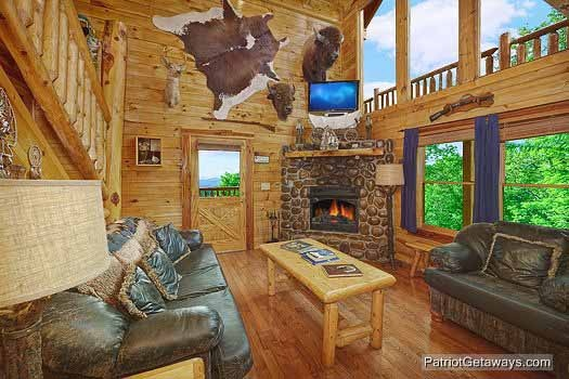 Living room with fireplace at Wild Bill's Hideout, a 2 bedroom cabin rental located in Gatlinburg