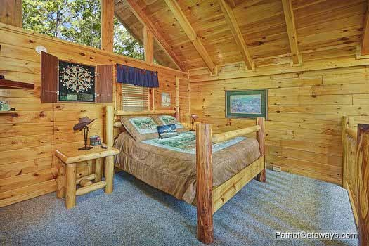 lofted bedroom with queen bed at wild bill's hideout a 2 bedroom cabin rental located in gatlinburg