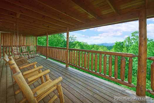 Lower deck with rockers and swing at Wild Bill's Hideout, a 2 bedroom cabin rental located in Gatlinburg