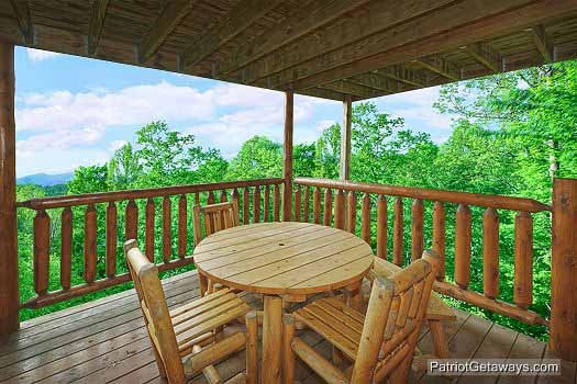 Main floor deck dining area at Wild Bill's Hideout, a 2 bedroom cabin rental located in Gatlinburg