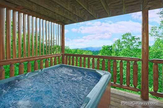 main floor deck with hot tub at wild bill's hideout a 2 bedroom cabin rental located in gatlinburg