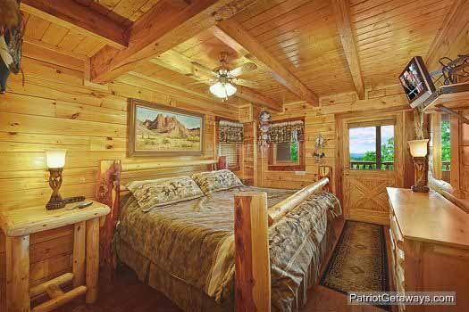 Master bedroom with king bed and jacuzzi at Wild Bill's Hideout, a 2 bedroom cabin rental located in Gatlinburg