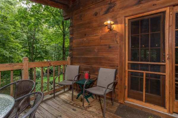 Deck furniture at Stream On! A 2 bedroom cabin rental located in Pigeon Forge