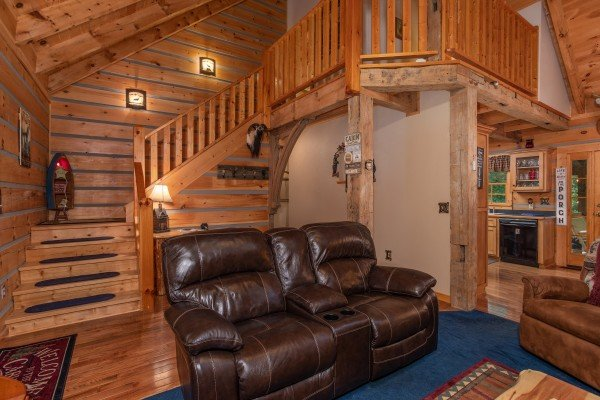 Double recliner in the living room at Stream On! A 2 bedroom cabin rental located in Pigeon Forge