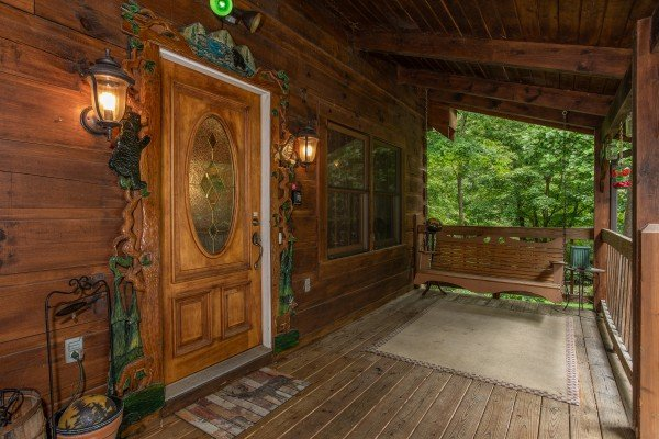 Front door and entry porch at Stream On! A 2 bedroom cabin rental located in Pigeon Forge