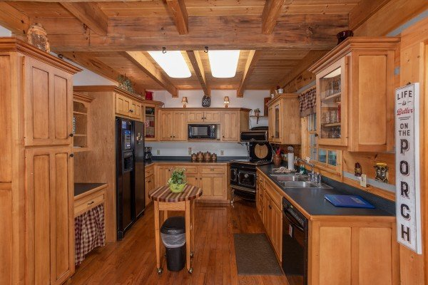 Kitchen with black appliances at Stream On! A 2 bedroom cabin rental located in Pigeon Forge