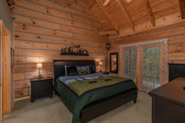 Bedroom with king bed and deck access at Stream On! A 2 bedroom cabin rental located in Pigeon Forge