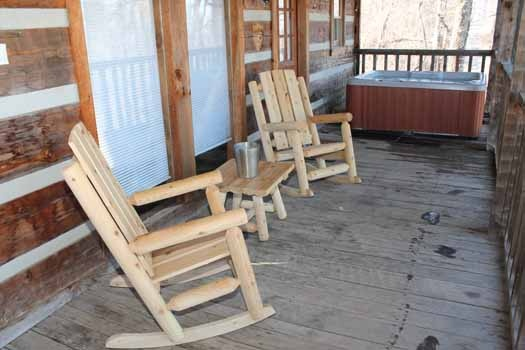 deck with rockers and hot tub at smoky mountain romance a 1 bedroom cabin rental located in pigeon forge