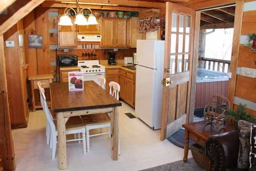 dining area and kitchen at smoky mountain romance a 1 bedroom cabin rental located in pigeon forge