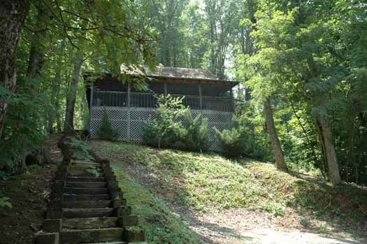 exterior front view at smoky mountain romance a 1 bedroom cabin rental located in pigeon forge