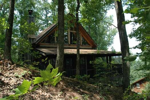 exterior side view at smoky mountain romance a 1 bedroom cabin rental located in pigeon forge