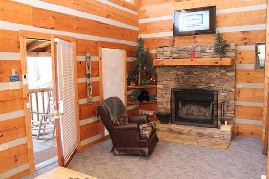 living room with fireplace at smoky mountain romance a 1 bedroom cabin rental located in pigeon forge