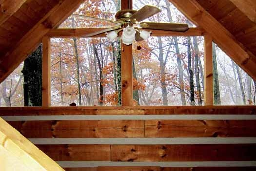 main level cathedral ceilings with fan at smoky mountain romance a 1 bedroom cabin rental located in pigeon forge