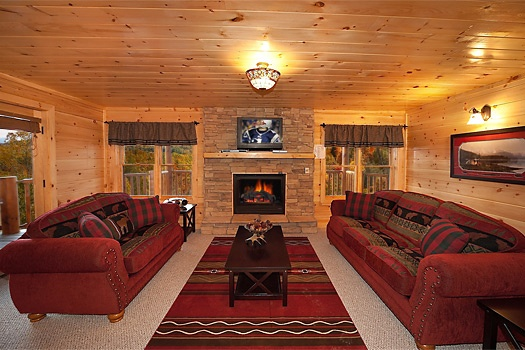 game room with sofa bed at lookout lodge a 4 bedroom cabin rental located in pigeon forge