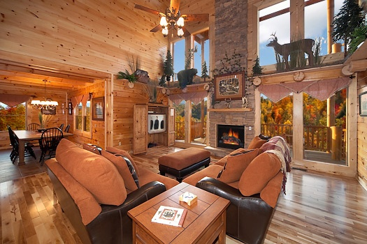 living room with stone fireplace at lookout lodge a 4 bedroom cabin rental located in pigeon forge