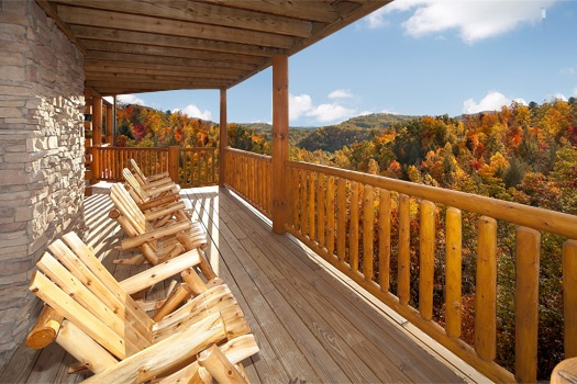 mountain views from the chairs on the deck at lookout lodge a 4 bedroom cabin rental located in pigeon forge