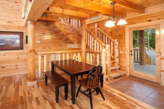 small table by steps in the living room at lookout lodge a 4 bedroom cabin rental located in pigeon forge