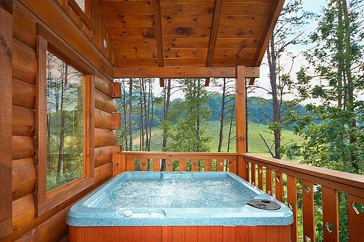 hot tub on a covered deck at always & forever a 1 bedroom cabin rental located in pigeon forge