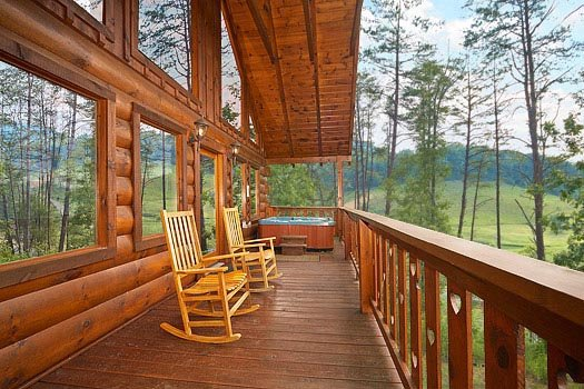 rocking chairs on the deck at always & forever a 1 bedroom cabin rental located in pigeon forge